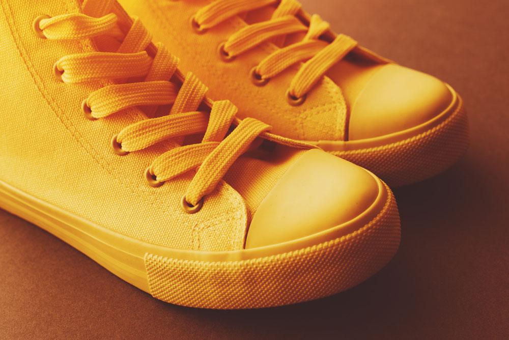 brand-new-yellow-sneakers-on-the-floor-PFSJDBG